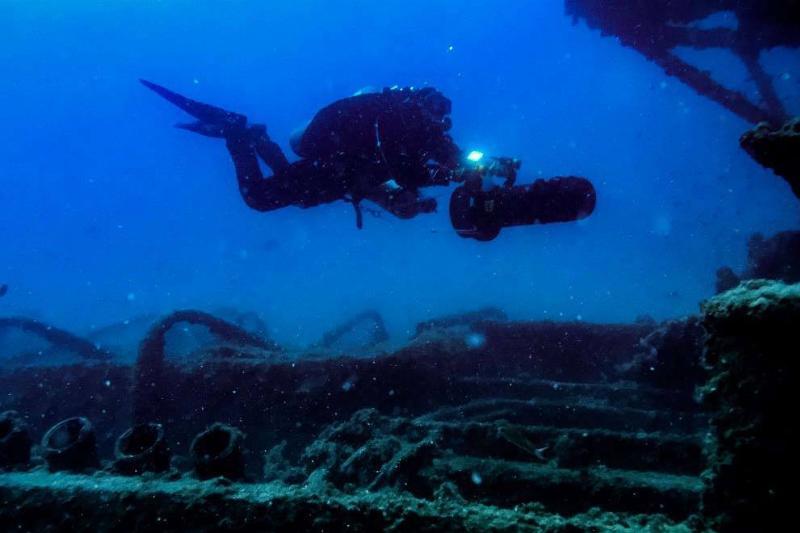 Diver searching shipwreck