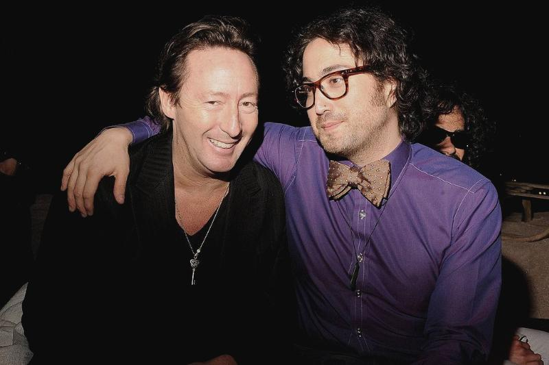 Sean Lennon grins with his arm around a smiling Julian.