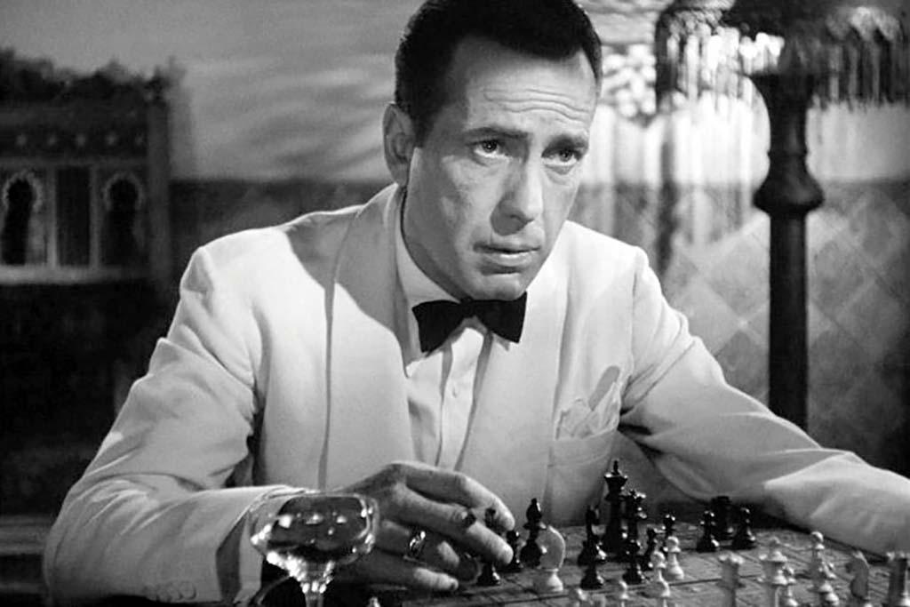 Bogart studying chess board