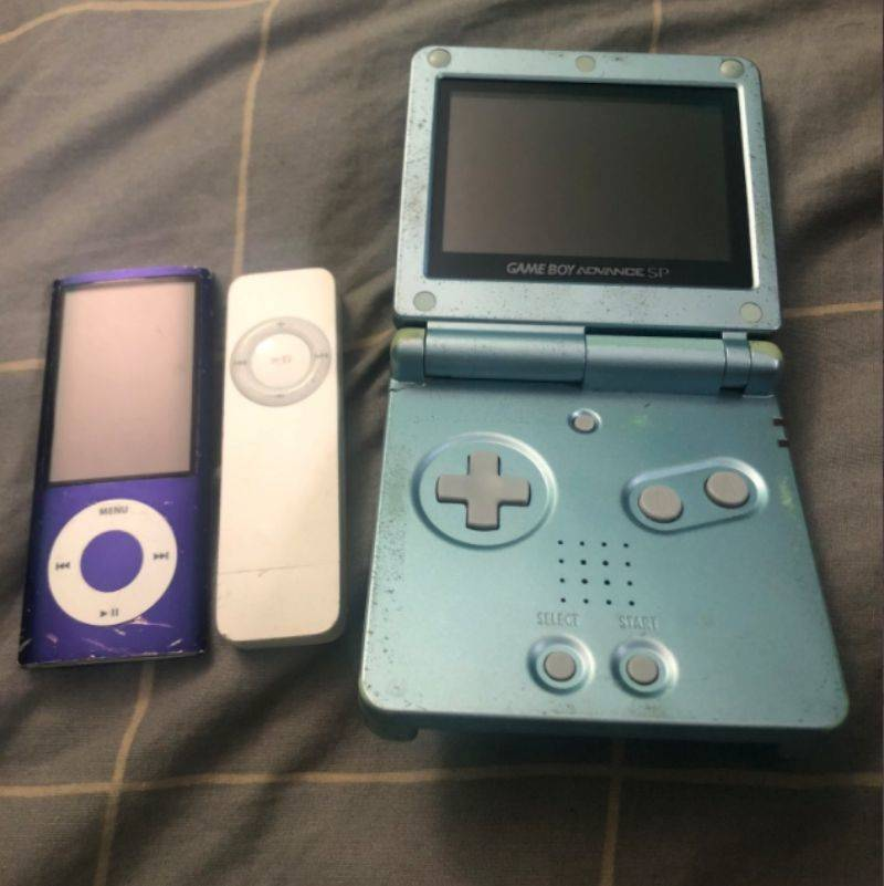 an old gameboy and ipod