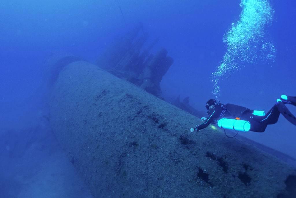 Diver investigating submarine