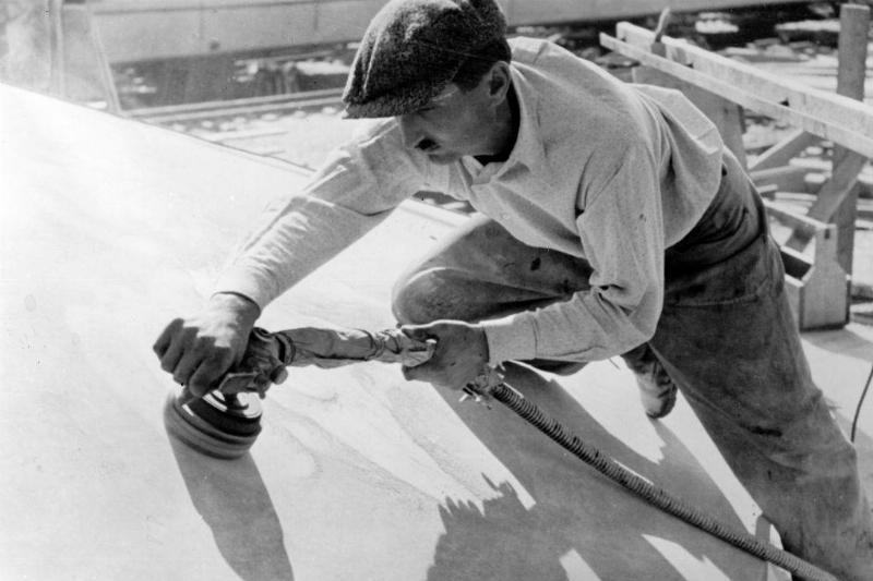 Man polishing ship