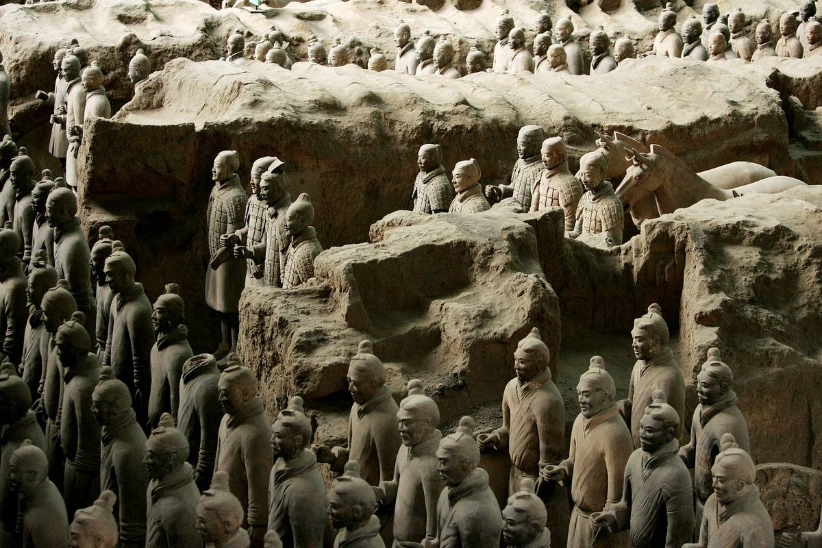 Emperor Qin Shi Huang's Terra Cotta Soldiers stand in rows.