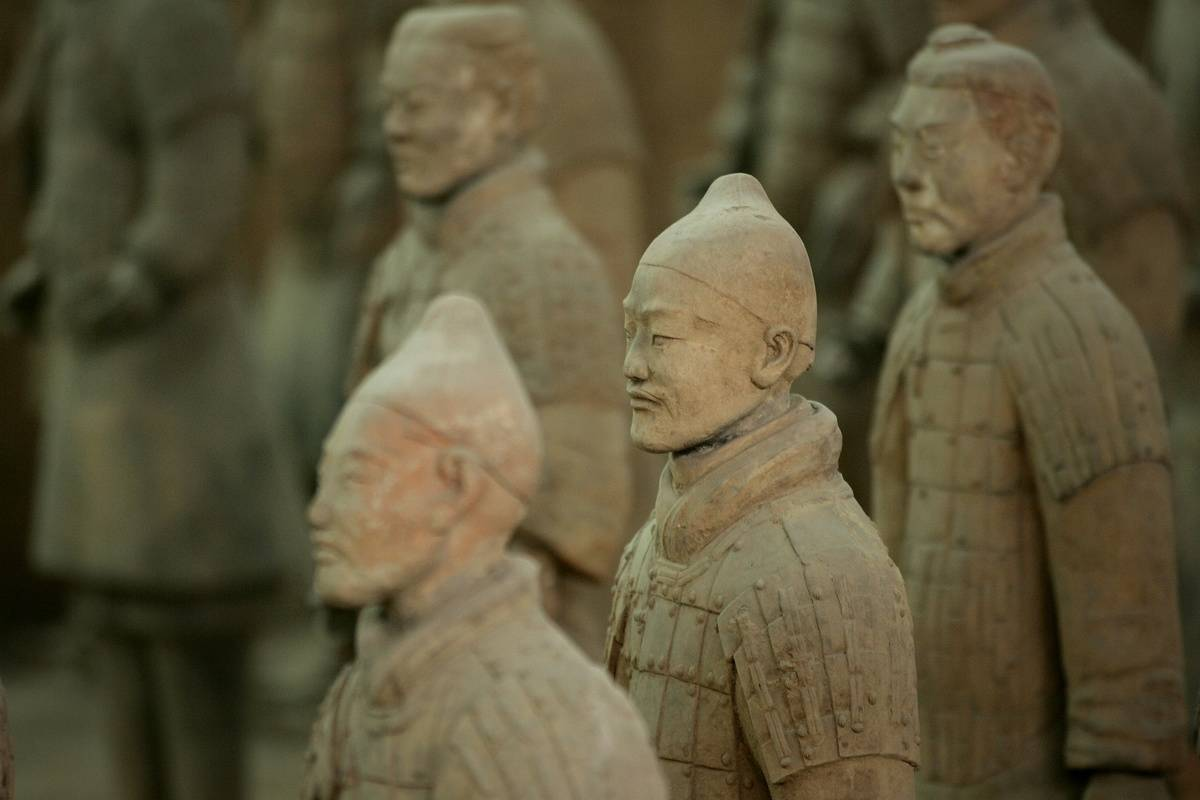 Life-sized clay soldiers stand in rows.