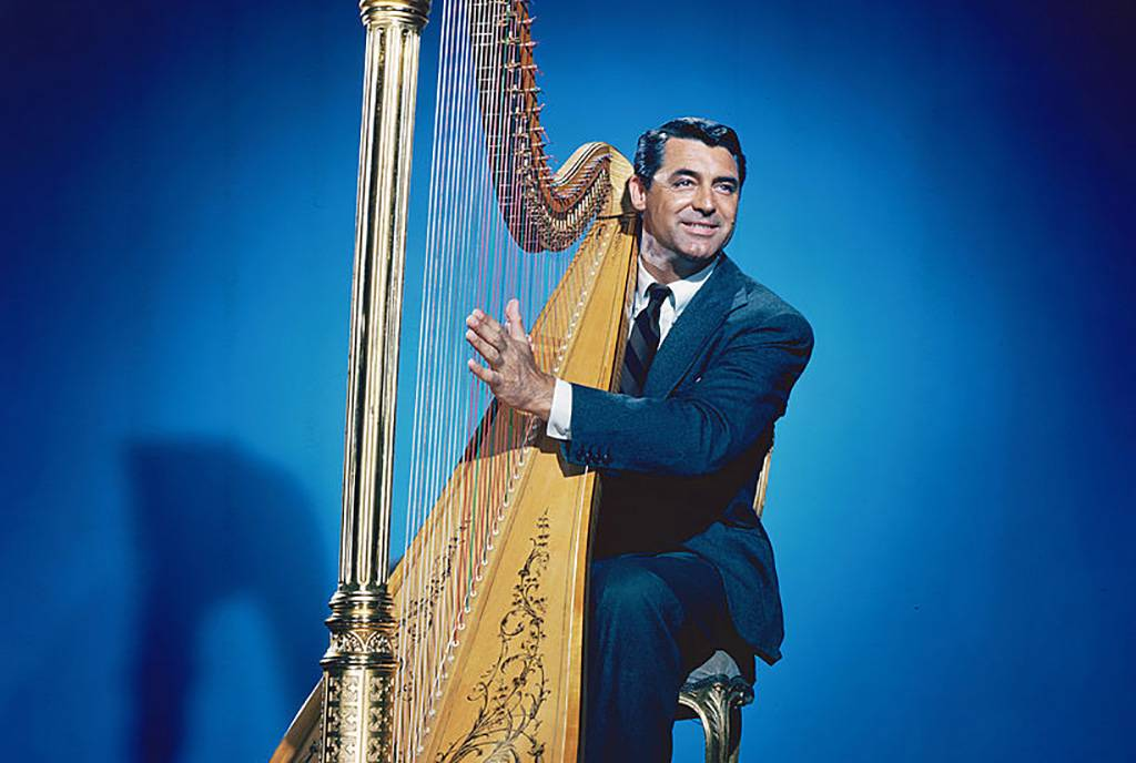 Grant playing the harp