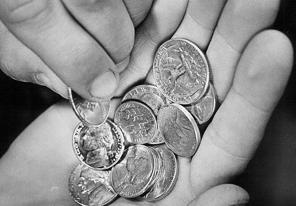 Person holding change