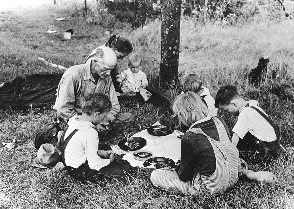 Family eating on the side of the road