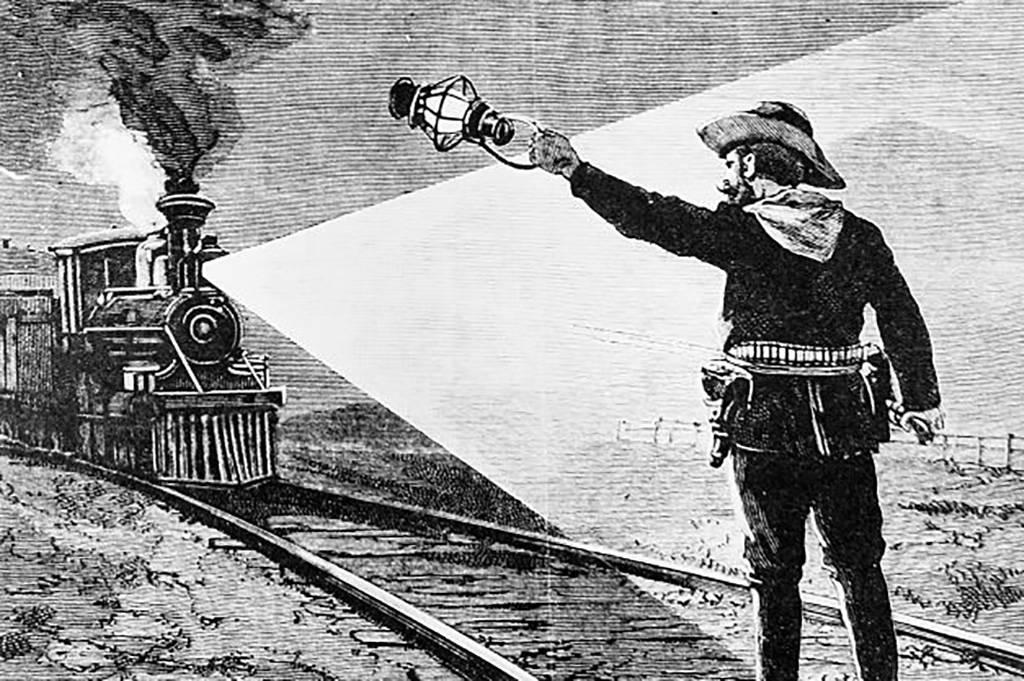 James waving down a train