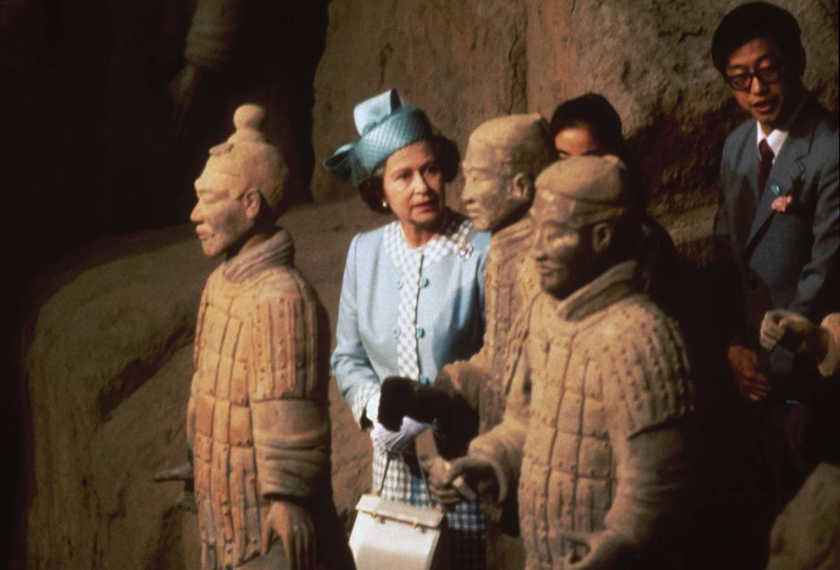 Queen Elizabeth II views some of the Terracotta Army soldier statues at the Qin Shi Huang's Museum Of The Terra-cotta Warriors And Horses.