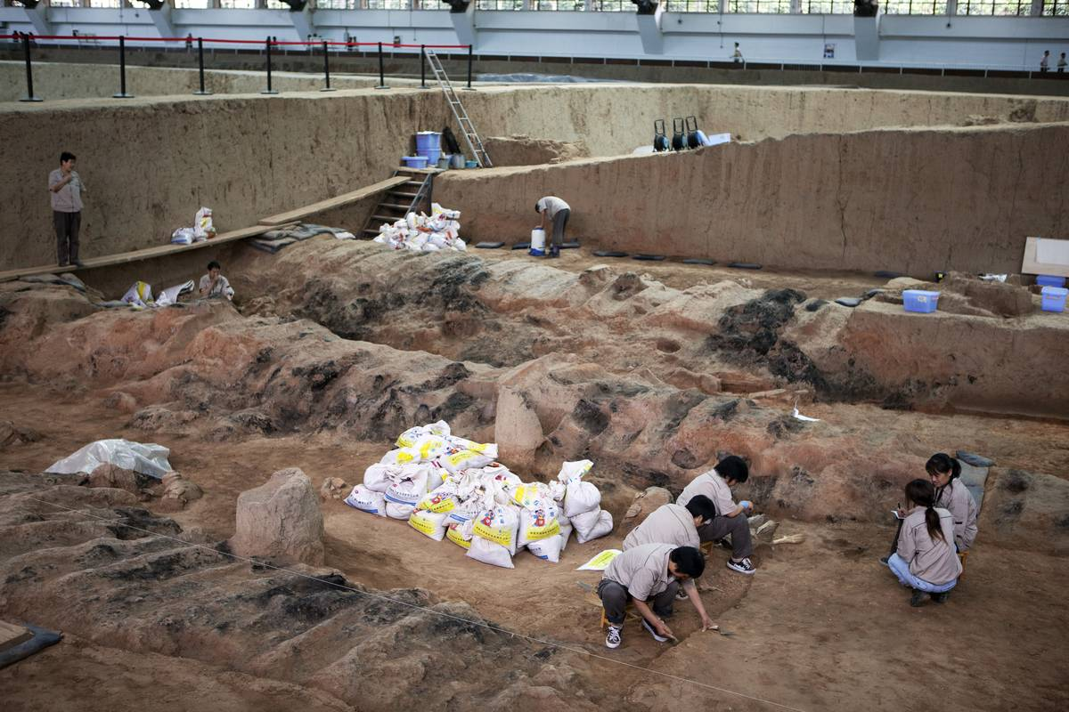 Archeologists work at one of the tombs of the Terracotta Warriors.