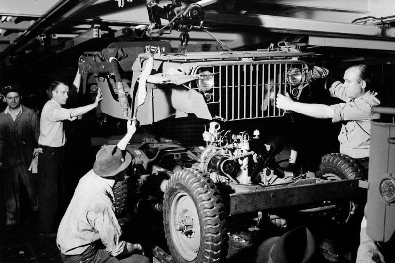 Men assembling Jeep