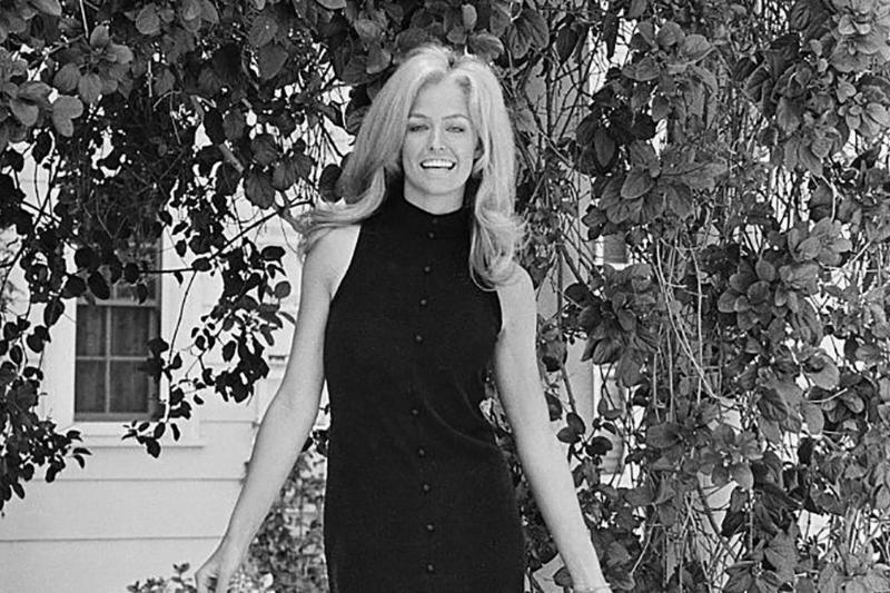 Fawcett in a black dress