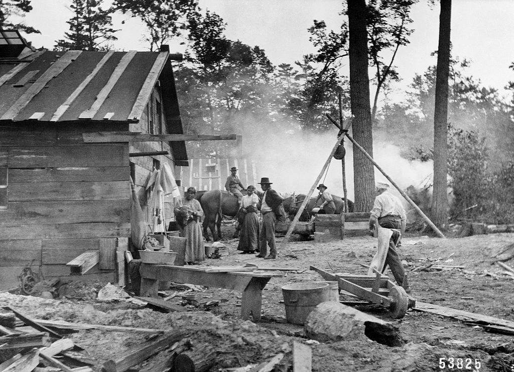 People in a logging camp