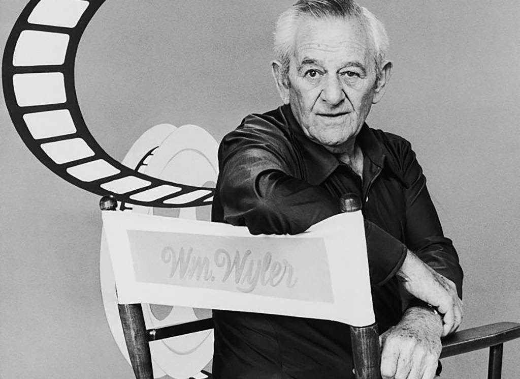 William Wyler in a directors chair