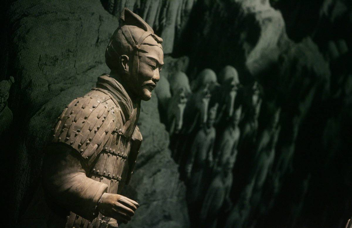 A terracotta warrior is displayed at a museum exhibition.