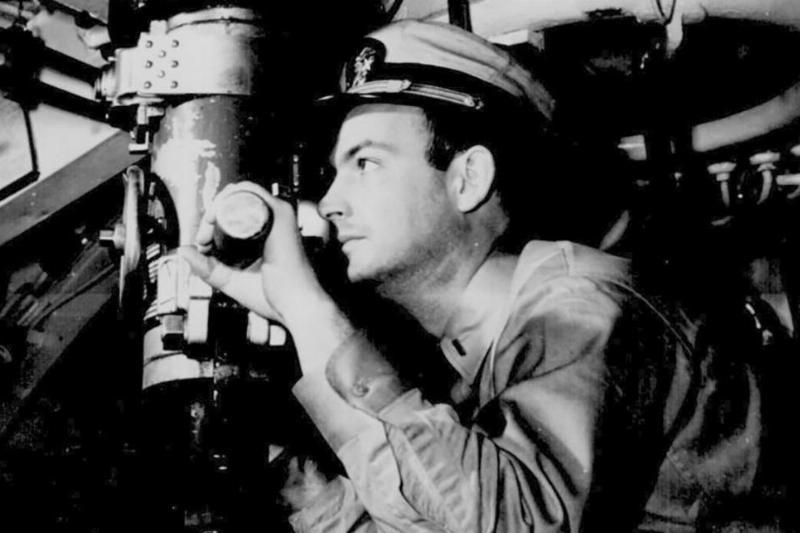 Man looking through periscope