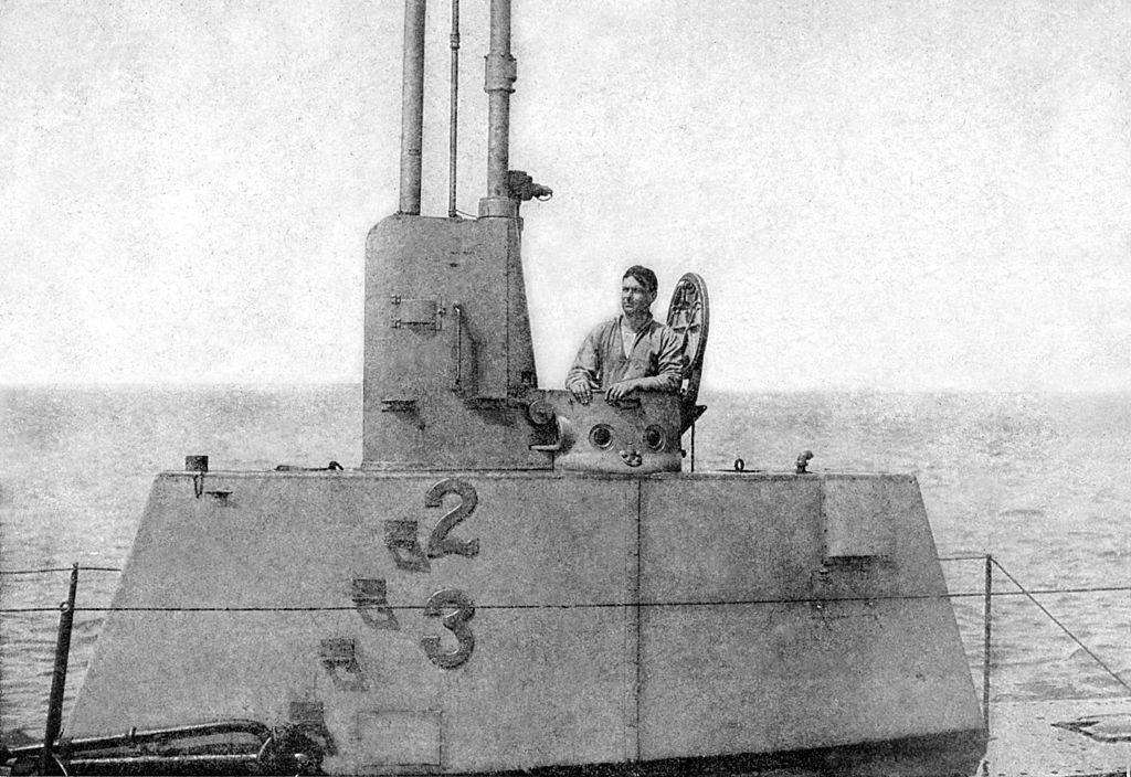 Man on top of a submarine