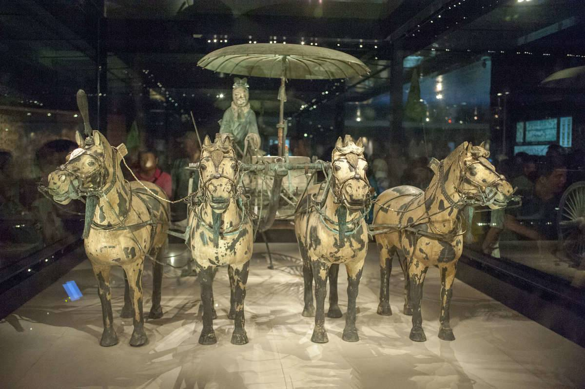 A terracotta warrior chariot is on display.