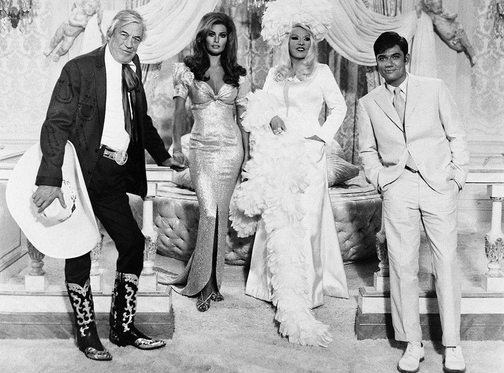 Left to right: John Huston as Buck Loner, Raquel Welch as Myra Breckinridge, Mae West as Leticia Van Allen, and Rex Reed as Myron.