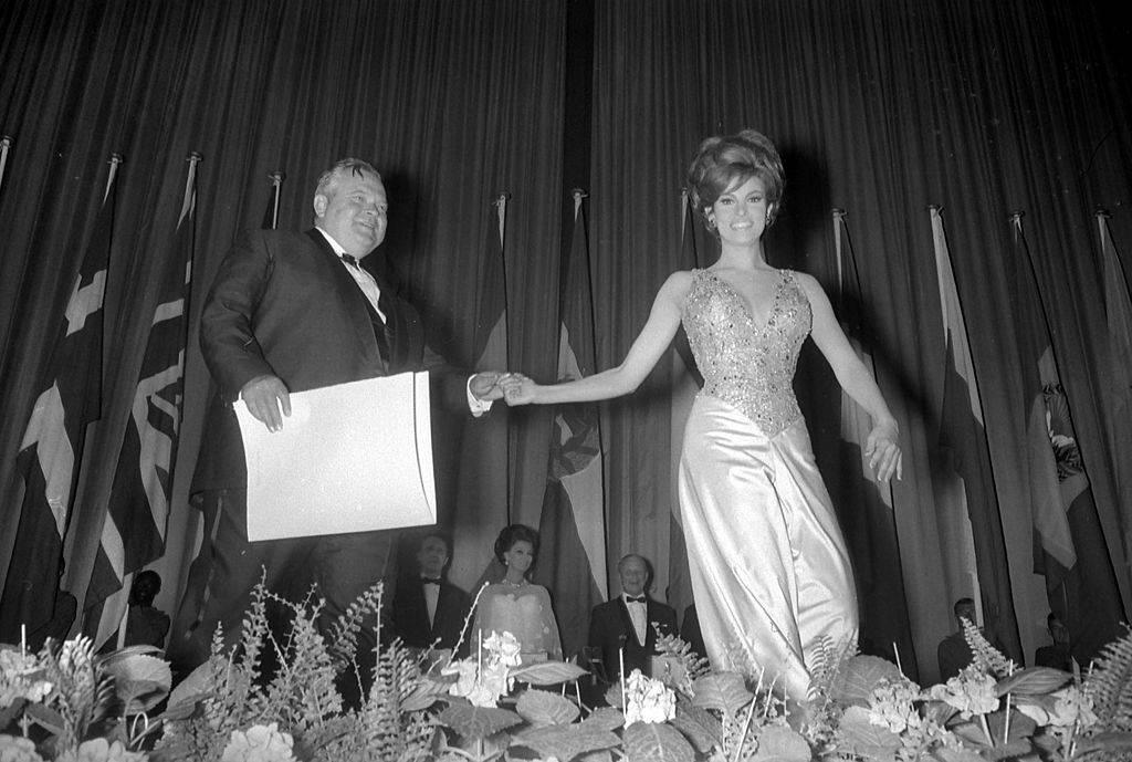 Raquel Welch handing an award to Orson Welles