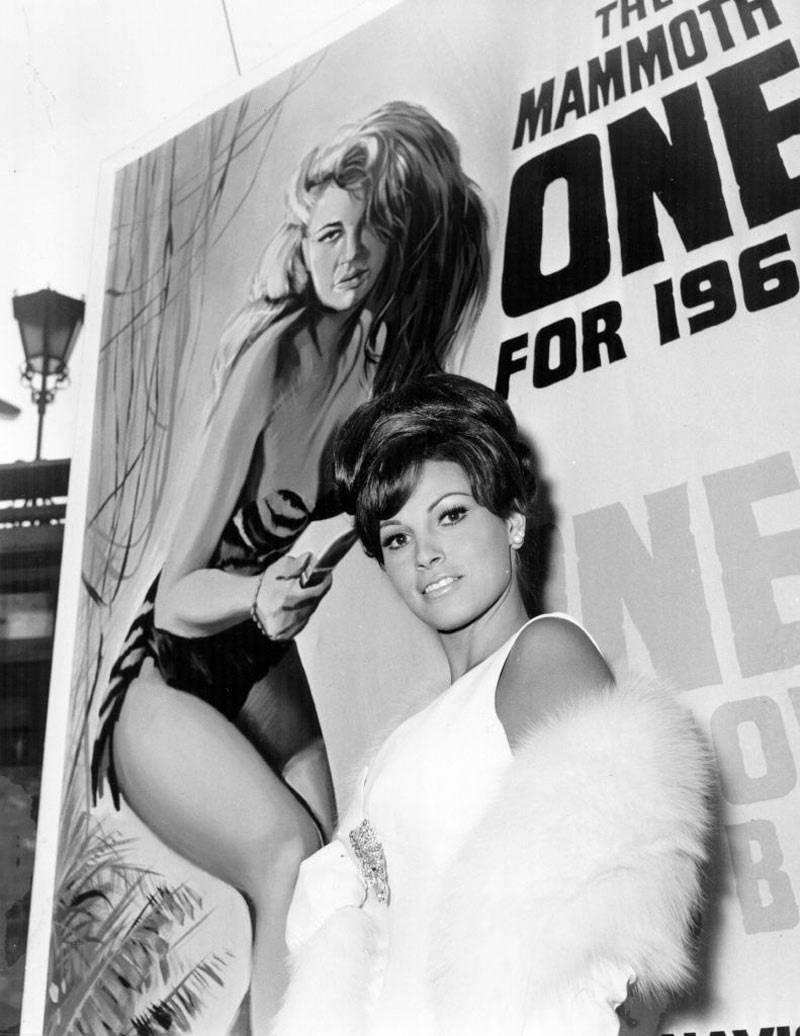 28th September 1965: US actress Raquel Welch in London, in front of a poster promoting her latest film 'One Million Years BC'