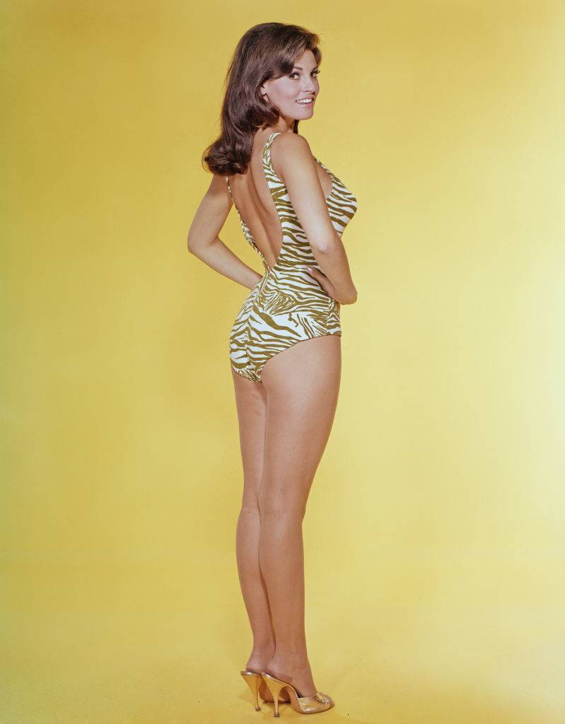 American actress Raquel Welch wearing a tiger-striped swimsuit, circa 1965.