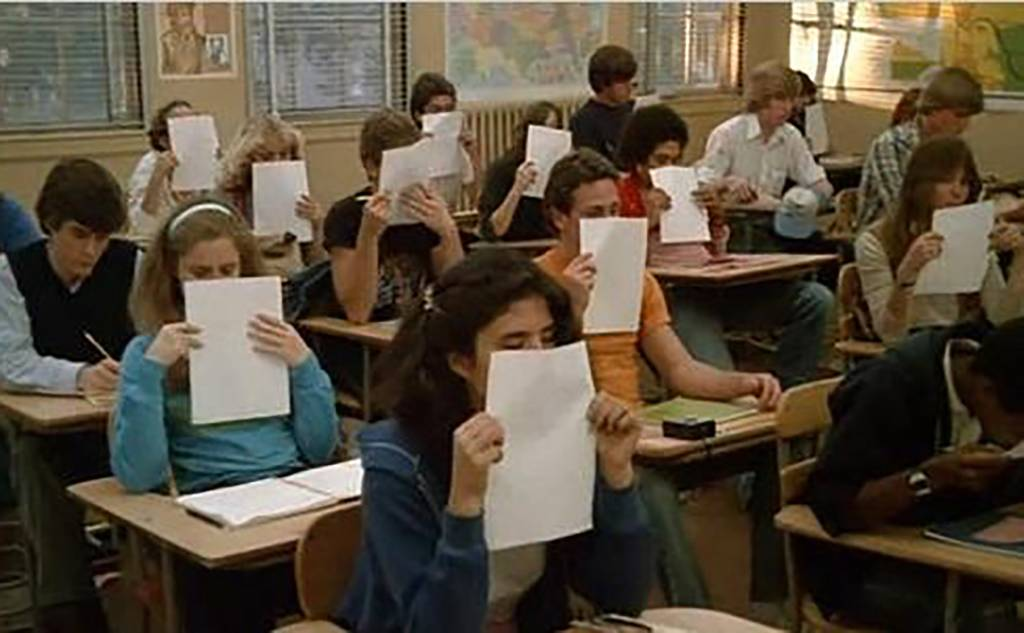Students smelling paper