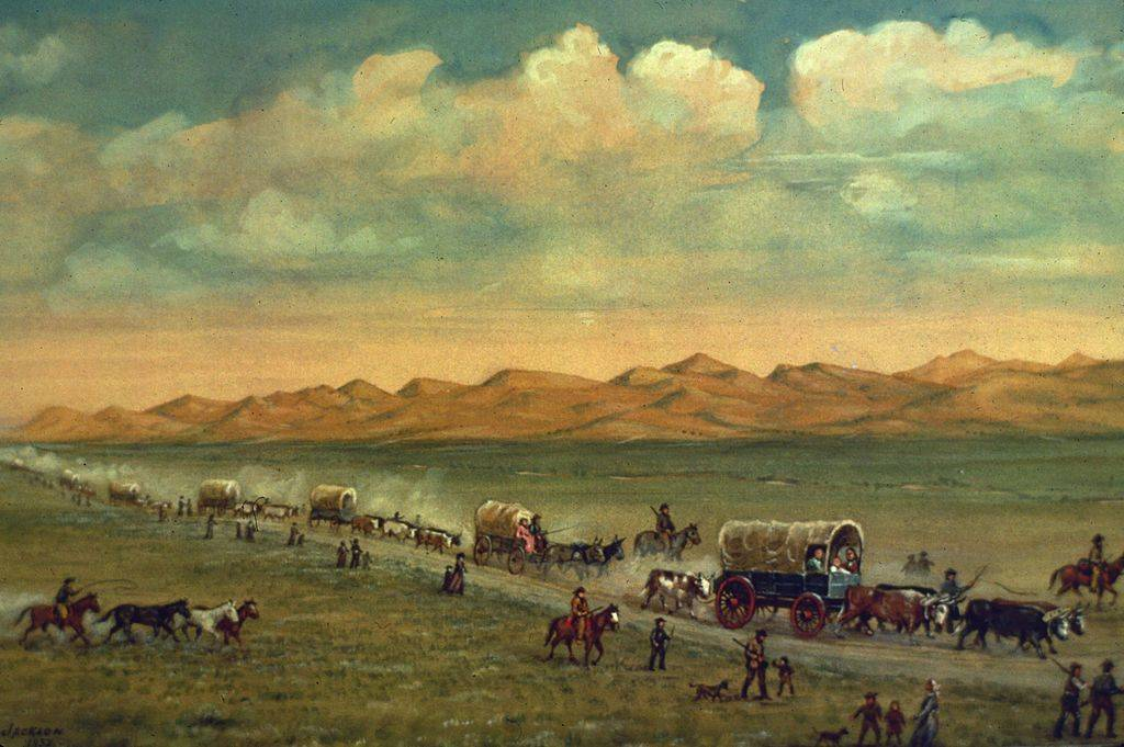 People traveling with wagons