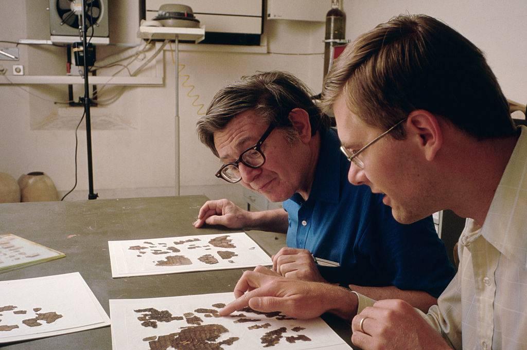 Men looking at fragments