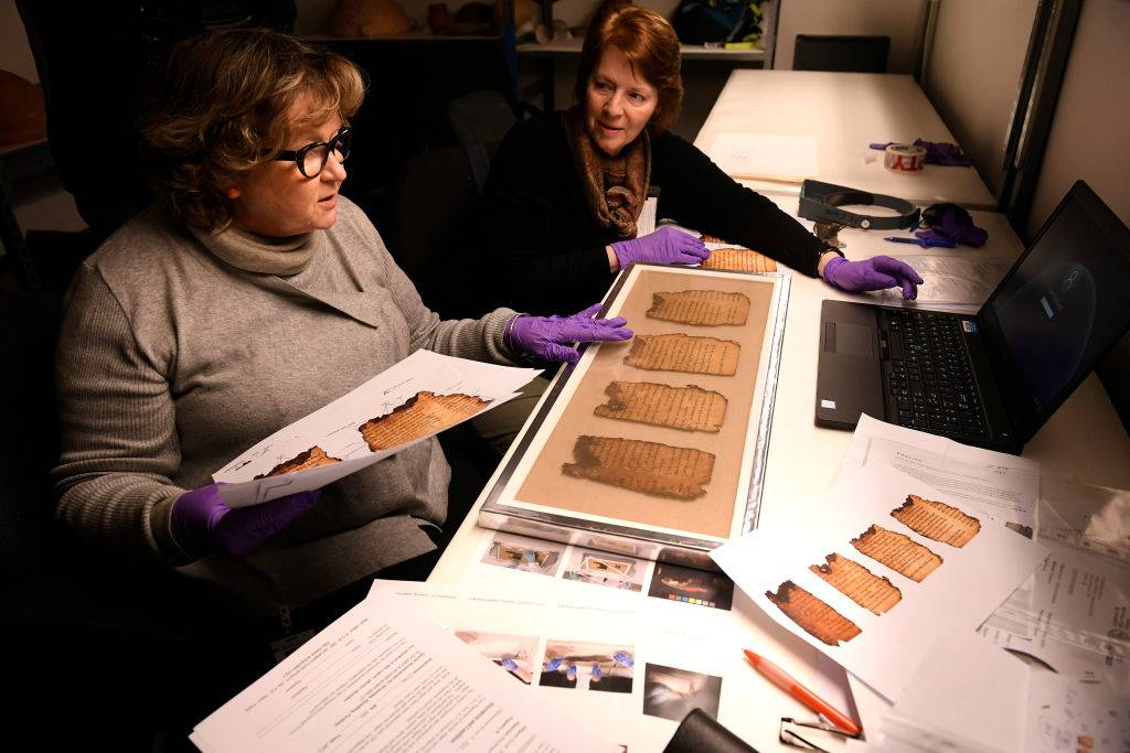 Women studying the scrolls