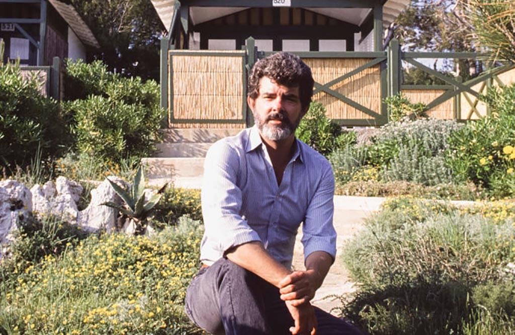 George Lucas kneeling