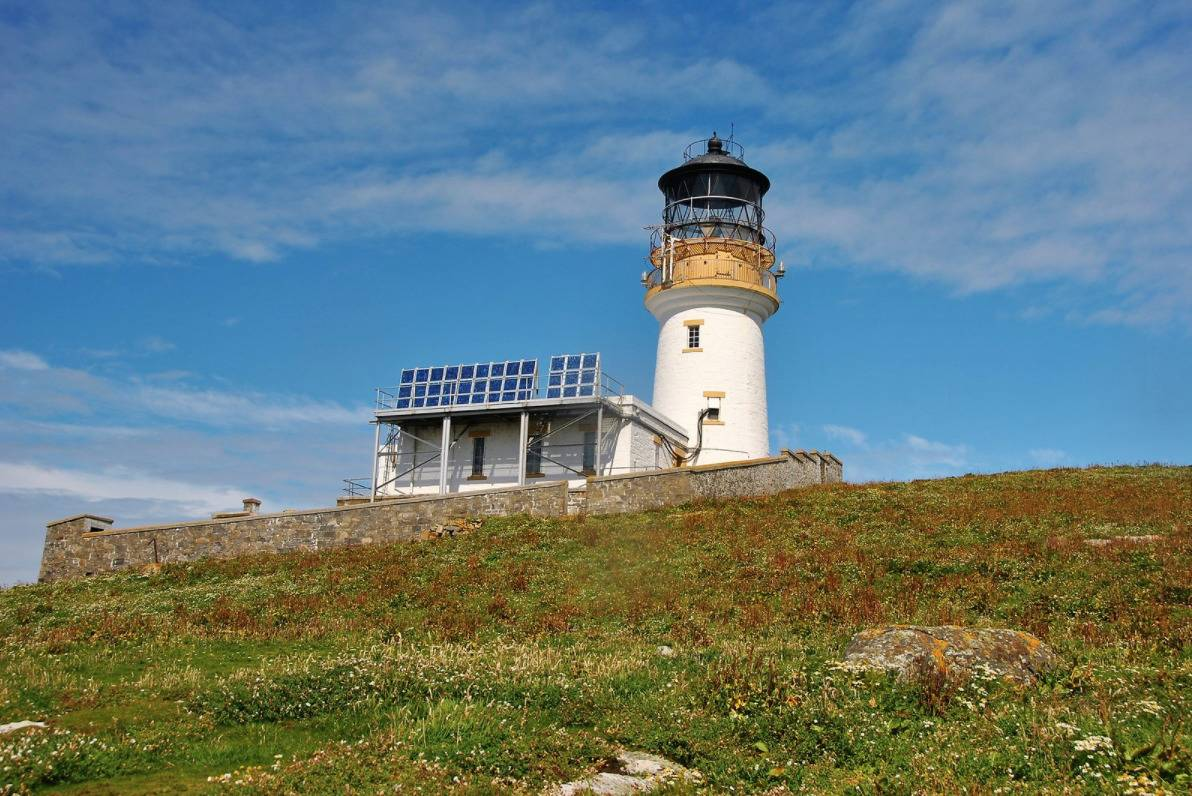 lighthouse on a green hill