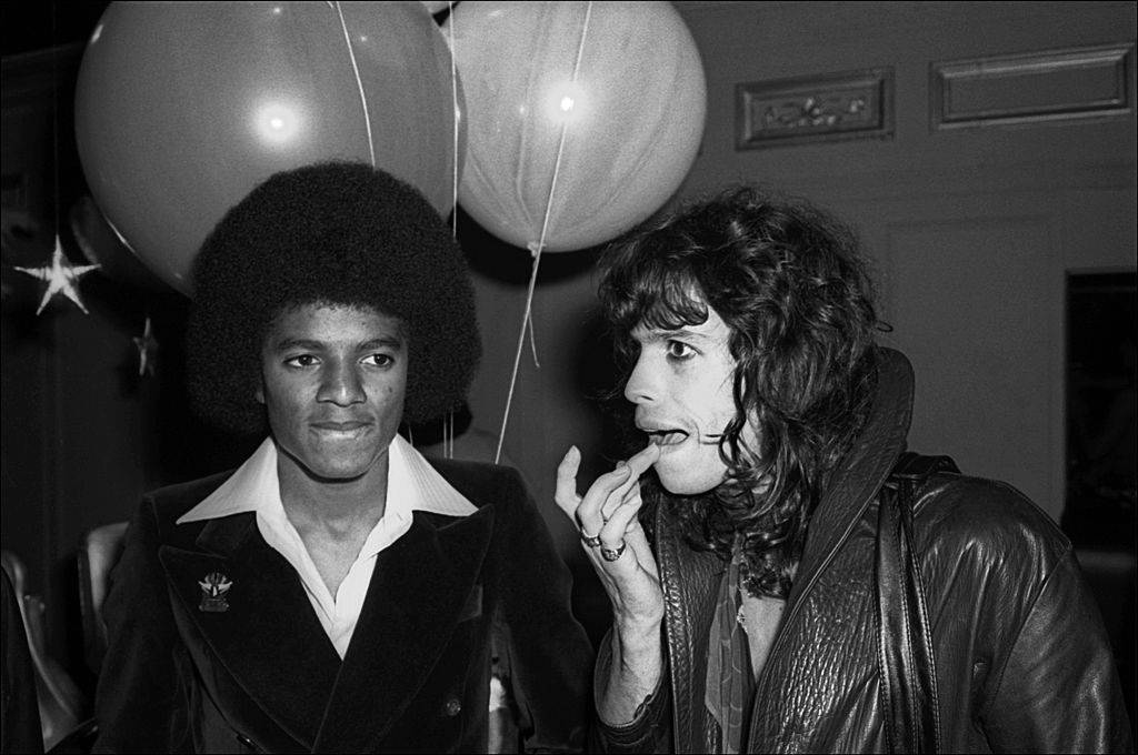 American musicians Michael Jackson, of the Jackson 5, and Steve Tyler, of the group Aerosmith, attend a Beatlemania party at Studio 54, New York, New York, June 9, 1977. (Photo by Allan Tannenbaum/Getty Images)