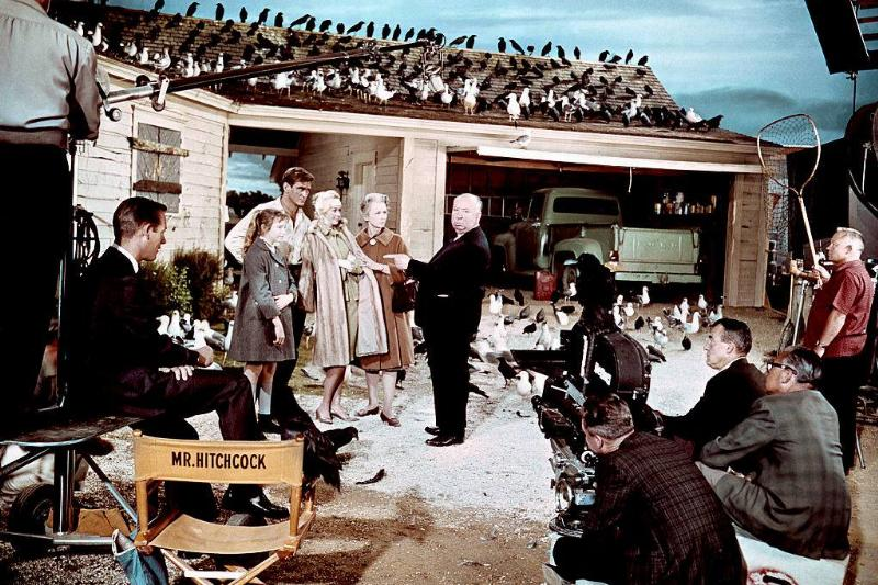 British actress Veronica Cartwright, Australian actor Rod Taylor, American actress Tippi Hedren and British Jessica Tandy with director and producer Alfred Hitchcock on the set of Hitchcock's movie The Birds.