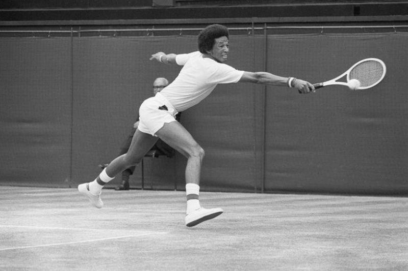 american-tennis-player-arthur-ashe-grimaces-as-he-hits-a-news-photo-1573930427