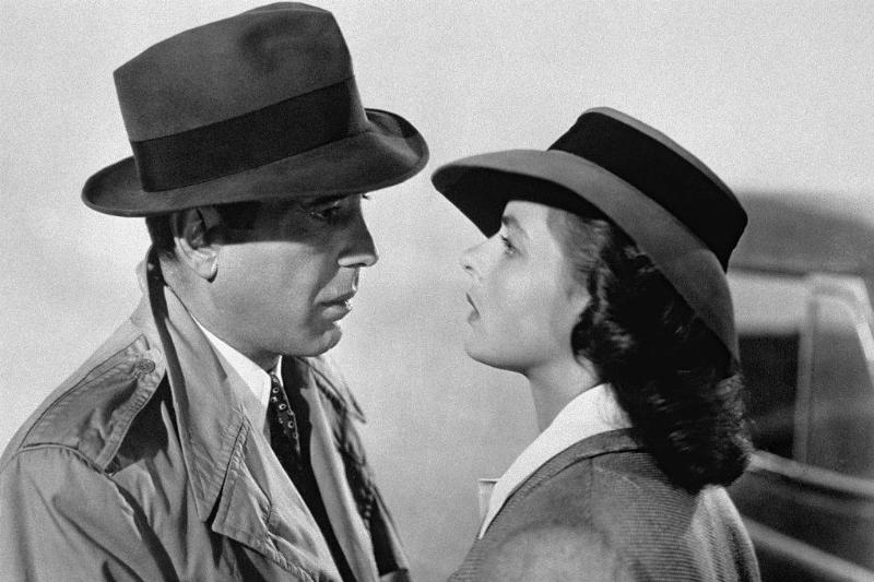 Humphrey Bogart and Ingrid Bergman wearing hats in a black and white still from Casablanca