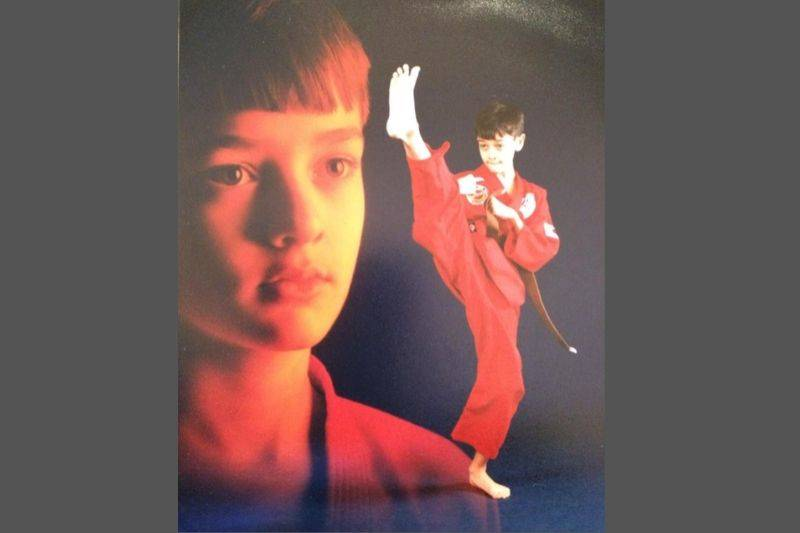 karate photo with closeup of boy in background