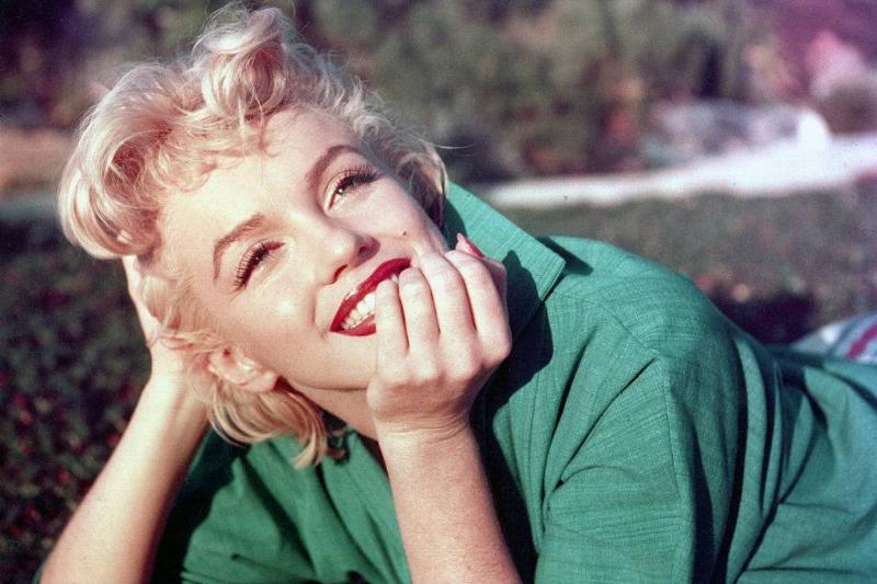 marilyn monroe wearing a green blouse and red lipstick