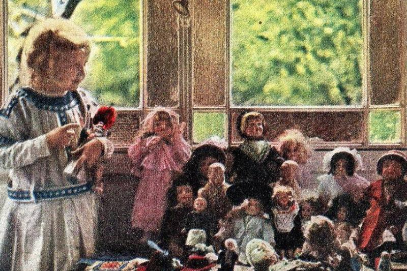 young girl with dolls