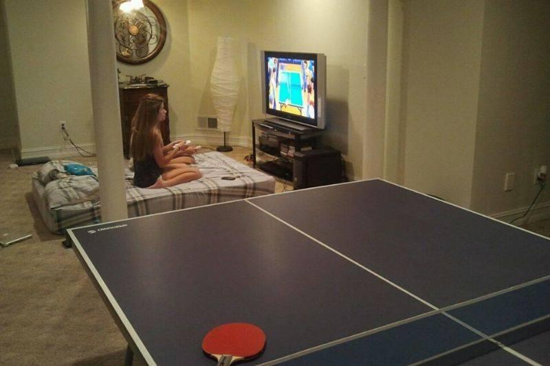 a girl playing ping pong on the wii