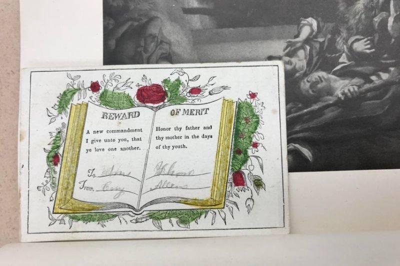 a reward of merit in a book