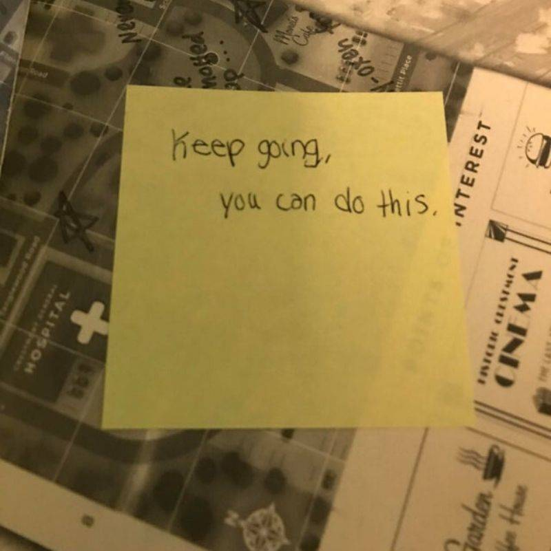 a sticky note that reads,
