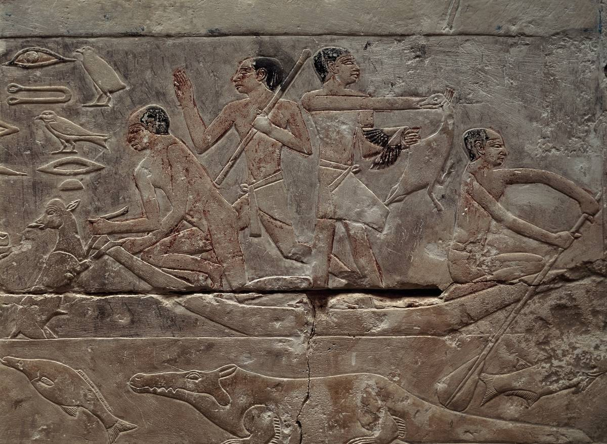 An Egyptian carving depicts men fishing in a boat.