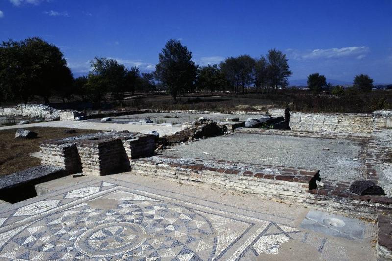 Mosaics decorate the floor of ancient Greek public baths.