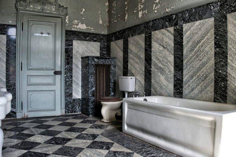 a bathroom in an old mansion