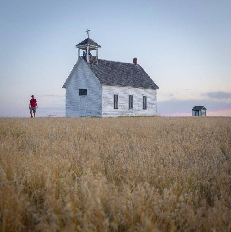 an old church in a field