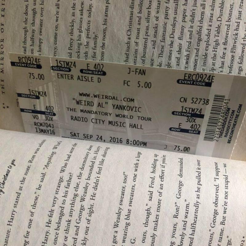 a Weird Al ticket in a book