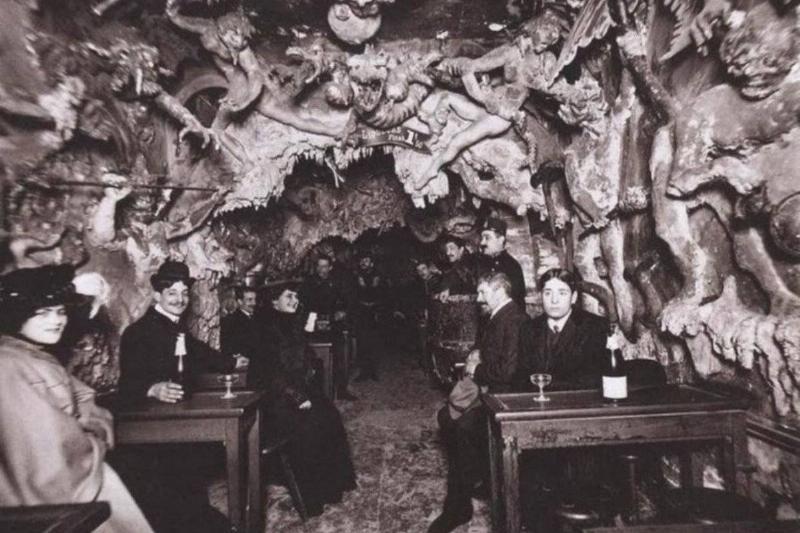 Customers sit at the Cabaret de l'Enfer in Paris, France.