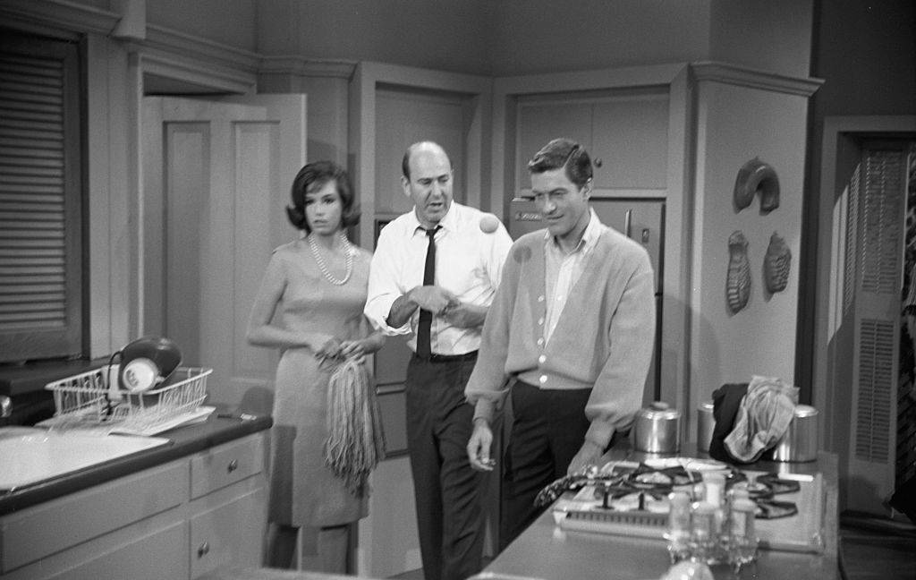 Actors Dick Van Dyke and Mary Tyler Moore with writer, producer, director and actor Carl Reiner in rehearsal for The Dick Van Dyke Show