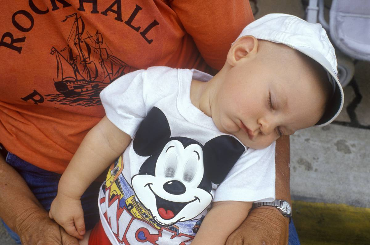 Baby asleep in fathers arms